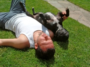 dog-boy-sunbathing-410